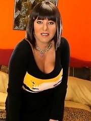 Buxom ebony t-girl posing in tight dress
