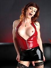Stunning Jasmine posing in a sexy latex miniskirt