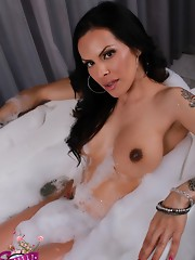 Gorgeous transsexual Foxxy taking a bath