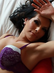 Gorgeous tgirl Foxxy posing on the bed