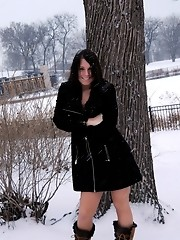 Naughty tgirl Ashley George posing outdoors in the snow