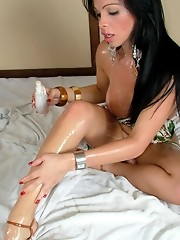 Brunette shemale strokes her shecock and fingers her asshole
