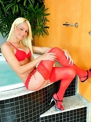 Big cocked tranny posing in hot red lingerie