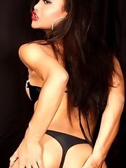 Ming In Fetish Wear Posing Her Big Fat Cock