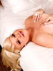 Hot shemale blondie Xena posing in the bed