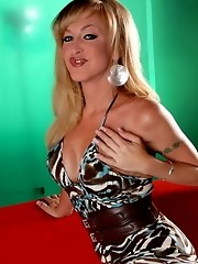 Big breasted transsexual Olivia Love photoshoot