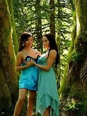 Sexy Carmen posing with Mia on a mystical tree